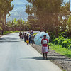 woman with  umbrella along the road - Uganda-7527