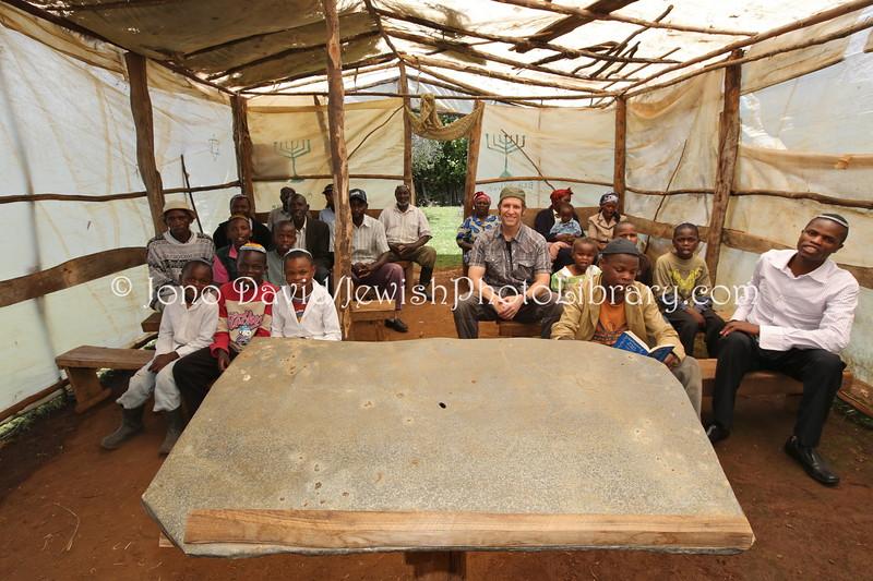 KE 562  Jono David with the Kasuku community