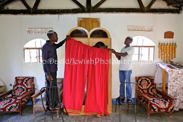 UGANDA, Mbale District, Nabugoye Village. Changing of the parochet for Rosh Hashanah (2013-5774), Moses Synagogue. Abayudaya Jews. (9.2013)
