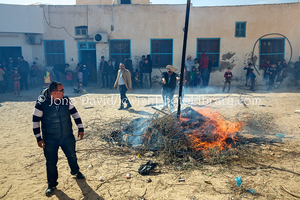 TUNISIA, Djerba, Hara Kebira. Burning Haman's effigy for Purim (3.2016)