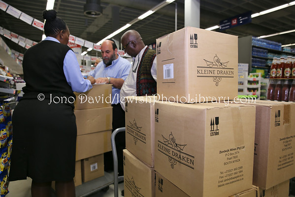 SOUTH AFRICA, Gauteng, Johannesburg, Norwood. Passover goods shipment preparation for Bulawayo and Harare, Zimbabwe, prepared by Rabbi Moshe Silberhaft, at Pick n Pay supermarket, Norwood Mall (3.2014)