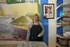 ZA 4602  Carol Wener, owner, under photo of founder, Goldie
