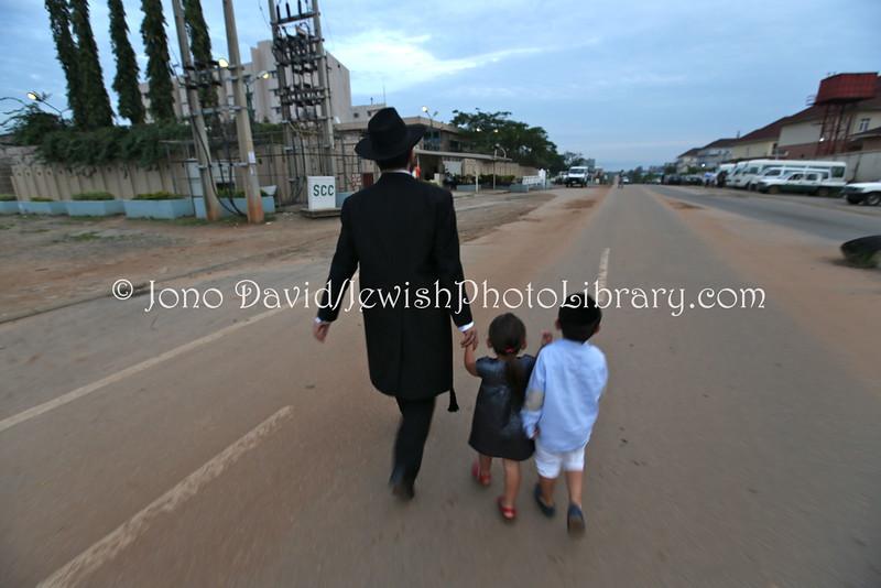 NG 33  Chabad-Lubavitch of Abuja Rabbi Israel Uzan walks to synagogue with his children  Abuja, NigeriaJPG