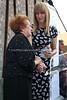 ZA 19440  Holocaust survivor Veronica Phillips presents JH&GC Director Tali Nates with a personal artifact  Dedication ceremony, Johannesburg Holocaust & Genocide Centre  Johannesburg, South Africa