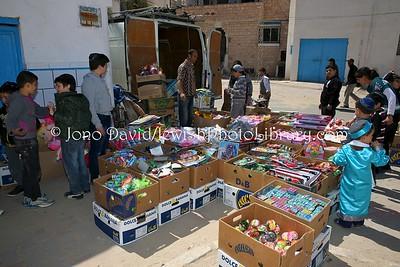TN 944  Purim morning street activity  Hara Kebira, Djerba, Tunisia