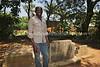 UG 141  Abayudaya Jews  Eliyahoo Muyamba, grandson of Samson Mugombe at (Rabbi) Samson Mugambe grave site, Namanyoni Village, Mbale, Uganda