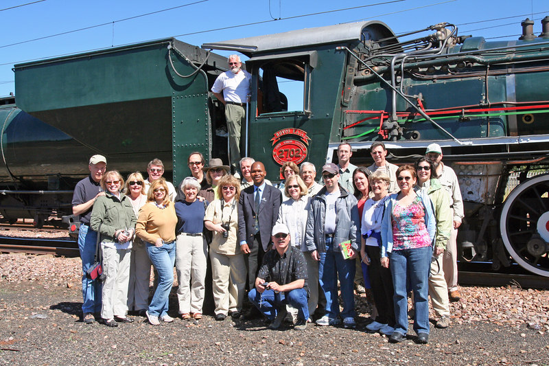 Some of the group in front of the engine.