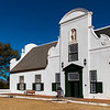 "Manor House at Groot Canstantia.  The Cape Gable was added between 1799 and 1803.  The sculpted figure of ""Abundance"" was the work of Anton Anrieth."