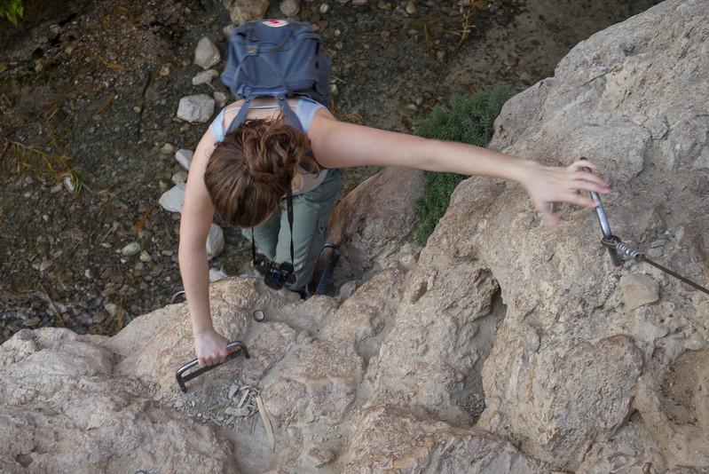 Teenage girl climbing on rock, Dead Sea Region, Israel