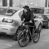 Jewish man walking with bicycle in street, Old City, Jerusalem, Israel