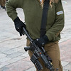 Close-up of female army soldier with rifle at Wailing Wall, Old City, Jerusalem