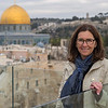 Portrait of happy woman with Dome of the Rock in the background, Old City, Jerusalem, Israel