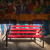 Empty bench in front of street art on building wall, Jerusalem, Israel