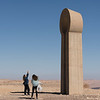 Tourists near sculpture in Sculpture Garden, Makhtesh Ramon, Negev Desert, Israel