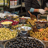 Olives for sale at market stall, Carmel Market, Tel Aviv, Israel