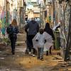 Family walking in street, Florentin, Tel Aviv, Israel