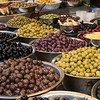 Variety of olives for sale at market stall, Carmel Market, Tel Aviv, Israel
