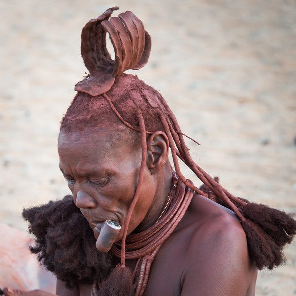 Older Himba woman and pipe