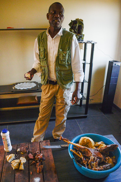 Our guide, Mandla, serves us a traditional lunch in his home village.