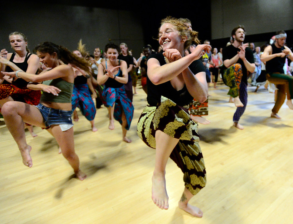 . CU Student Lydia Anne Jones dances in the final for the African Dance course at CU which was open to the public in the theater building on the University of Colorado Boulder Campus Sunday. For more photos and a video go to dailycamera.com. Paul Aiken Staff Photographer May 6 2018