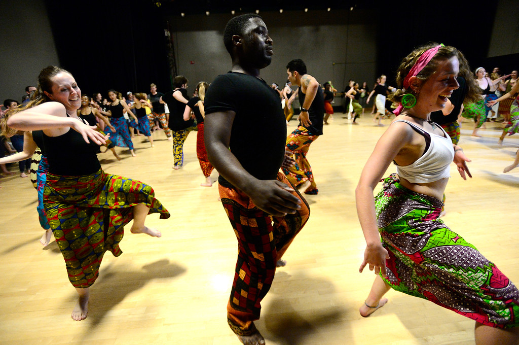 . From left to right Rachel Stauffer, Hardy Makanda Kumeso and Ciera Dykstra dance in the final class for the African Dance course at CU which was open to the public in the theater building on the University of Colorado Boulder Campus Sunday. For more photos and a video go to dailycamera.com. Paul Aiken Staff Photographer May 6 2018