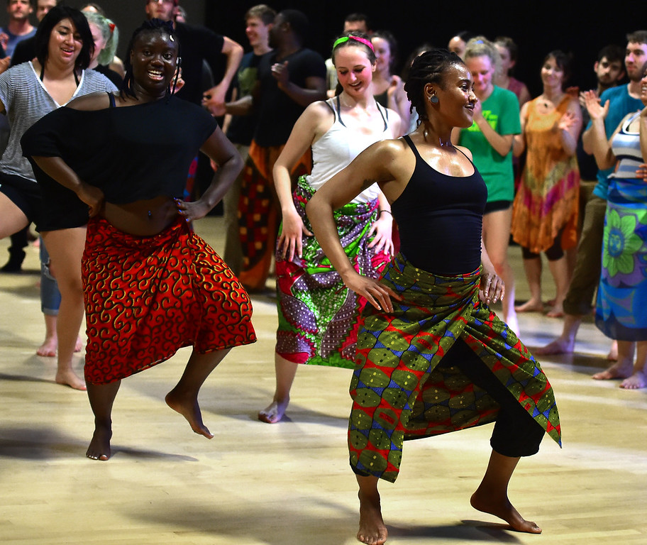 . Oumou Soumah, at left, and Briana Smith, step lively in the final for their African Dance class at CU which was open to the public in the theater building on the University of Colorado Boulder Campus Sunday. For more photos and a video go to dailycamera.com. Paul Aiken Staff Photographer May 6 2018
