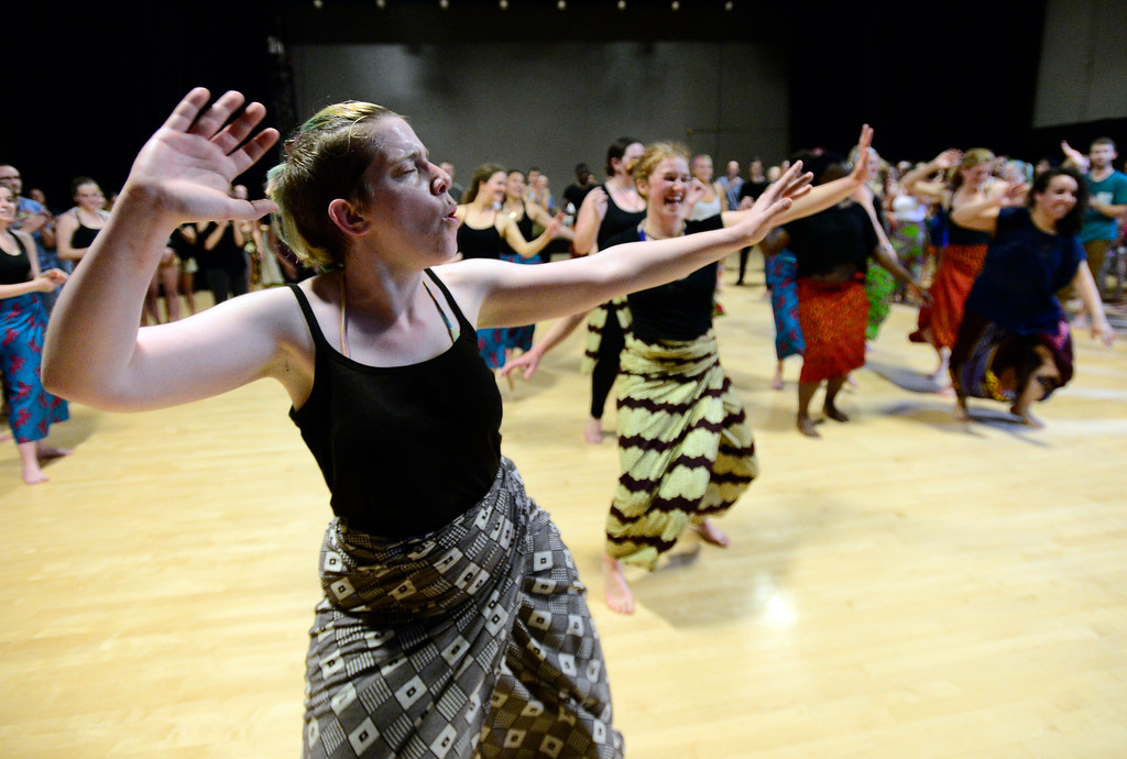 . CU graduate Elizabeth Neuhauser comes back to dance with the student in their final for the African Dance course at CU which  was open to the public in the theater building on the University of Colorado Boulder Campus Sunday. For more photos and a video go to dailycamera.com. Paul Aiken Staff Photographer May 6 2018