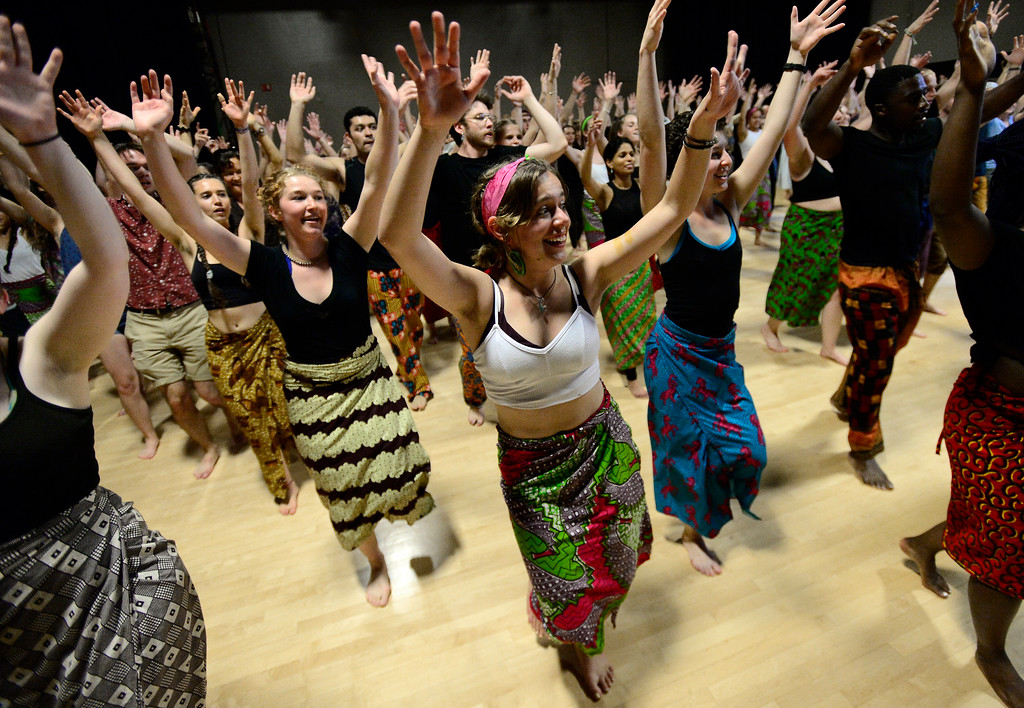 . CU Student Ciera Dykstra smiles as she and her fellow students and members of the community join in to dance in the final for the African Dance course in the theater building on the University of Colorado Boulder Campus Sunday. For more photos and a video go to dailycamera.com. Paul Aiken Staff Photographer May 6 2018
