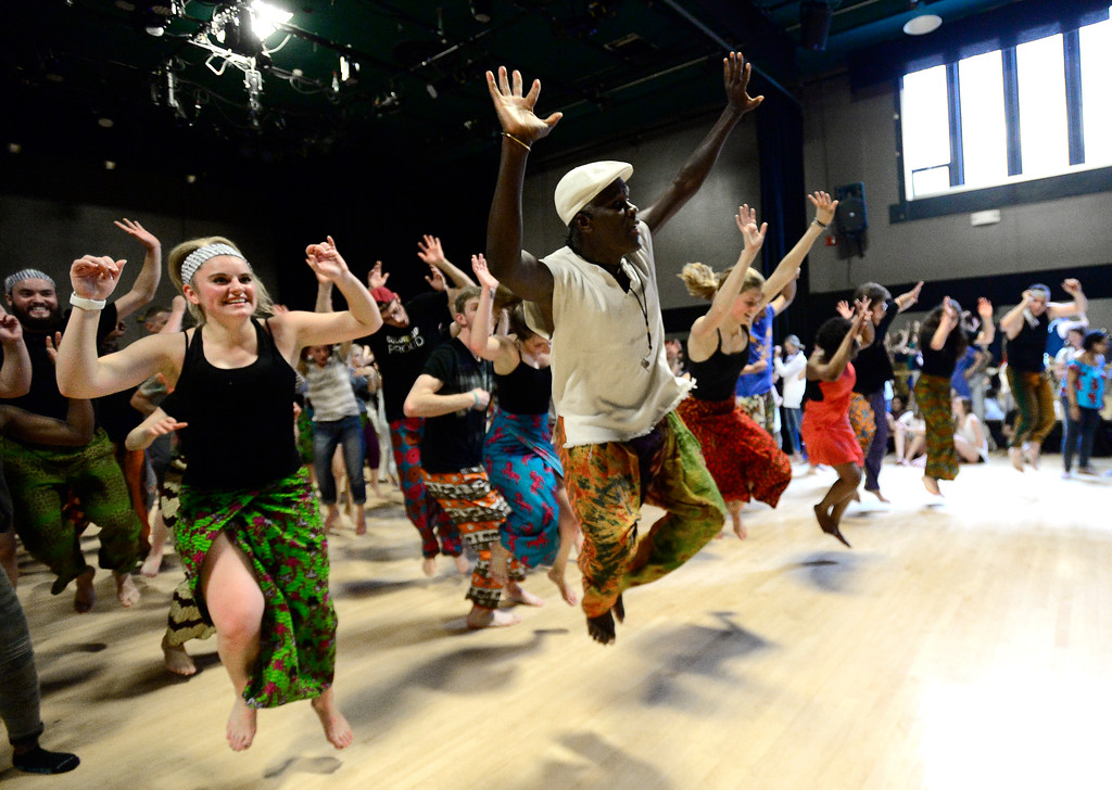 . Nicole Armstrong, left and Instructor Nii Armah Sowah lead the class in dance during a final which was open to the community for an African Dance course in the theater building on the University of Colorado Boulder Campus Sunday. For more photos and a video go to dailycamera.com. Paul Aiken Staff Photographer May 6 2018