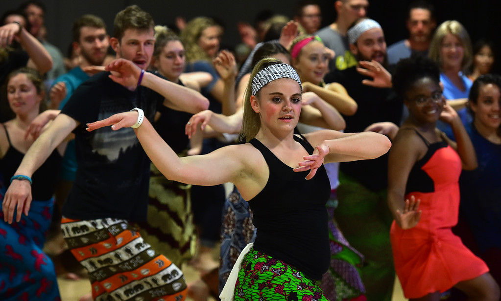 . Nicole Armstrong leads a dance for the final of her African Dance course at CU which was open to the public in the theater building on the University of Colorado Boulder Campus Sunday. For more photos and a video go to dailycamera.com. Paul Aiken Staff Photographer May 6 2018
