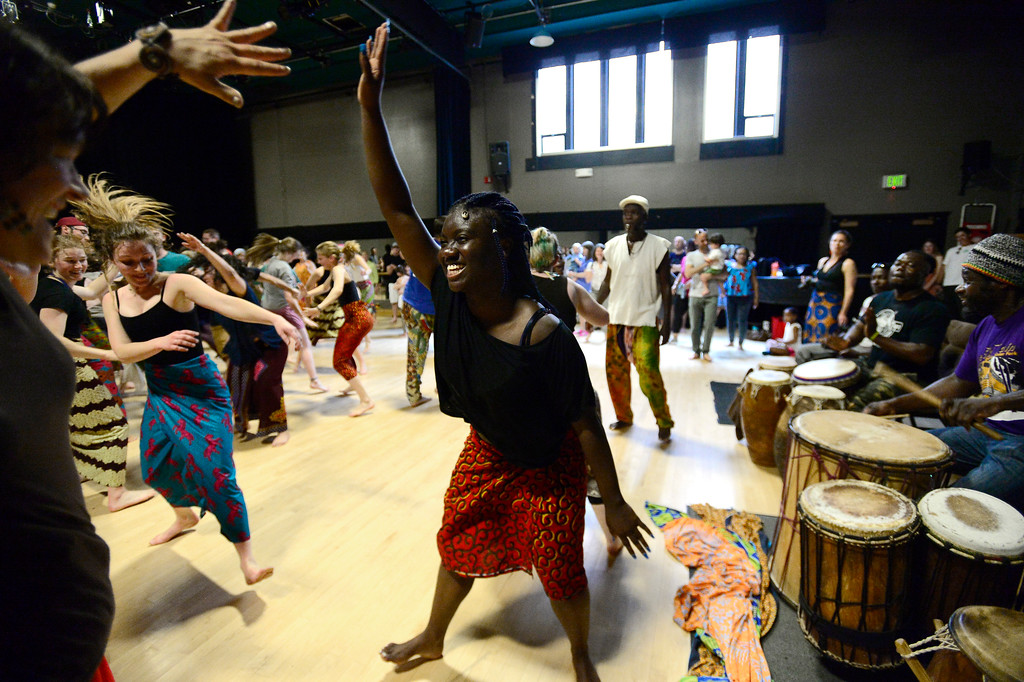 . Oumou Soumah dances with the drummers during the  final for the African Dance course at CU which was open to the public in the theater building on the University of Colorado Boulder Campus Sunday. For more photos and a video go to dailycamera.com. Paul Aiken Staff Photographer May 6 2018