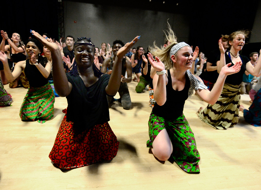 . Oumou Soumah, left, and Nicole Armstrong, clap together during the final  for the African Dance course at CU which was open to the public in the theater building on the University of Colorado Boulder Campus Sunday. For more photos and a video go to dailycamera.com. Paul Aiken Staff Photographer May 6 2018
