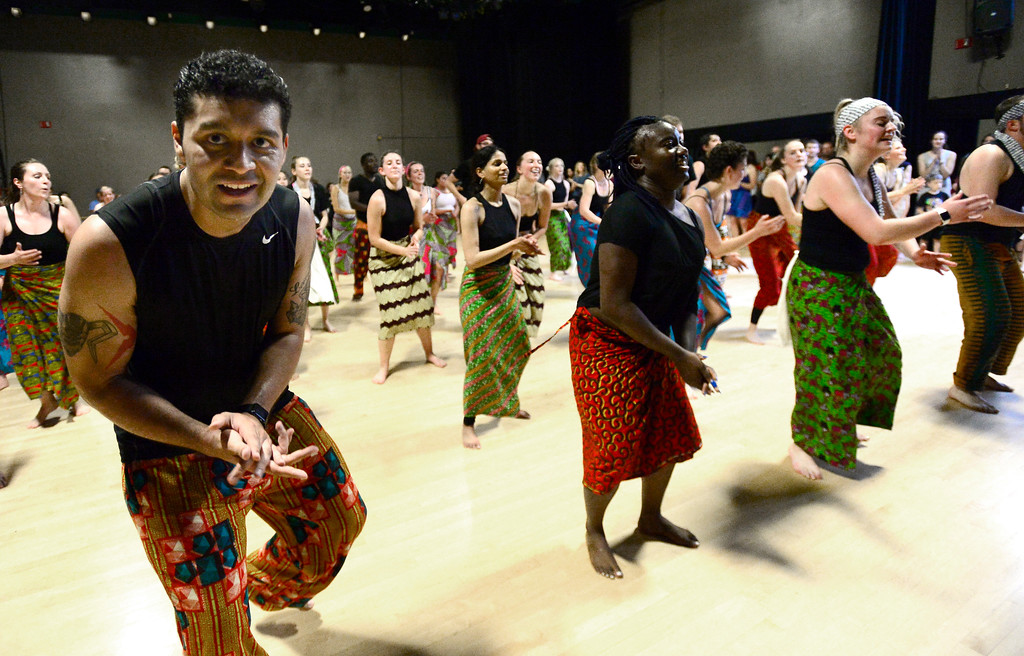 . Alex Perez claps for the crowd at his final for the African Dance course at CU which was open to the public in the theater building on the University of Colorado Boulder Campus Sunday. For more photos and a video go to dailycamera.com. Paul Aiken Staff Photographer May 6 2018