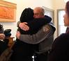 HOLLY PELCZYNSKI - BENNINGTON BANNER Kiah Morris and Bennington Police Chief Paul Doucette embrace in a hug on Monday afternoon at the Beth El Congregation in Bennington.