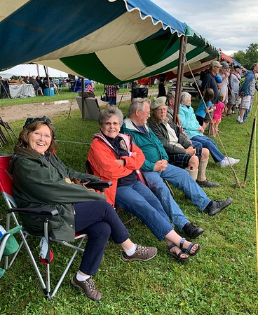 Kate Graham, Jane Graham, Dave Graham, and Richard Graham watching the Bear Racers come in and the border collie demonstrations.