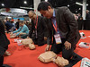 Attendees get Hands On CPR Training  during Hands-Only CPR Training