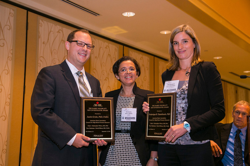 New Orleans, LA - AHA HBPR 2013 : Dr. Justin Grobe, left, and Dr Frederique B Yiannikouris, right, recieve the Harry Goldblatt New Investigator Finalists award at the HBPR Council and Kindey in Cardiovascular Disease Awards Luncheon   at the American Heart Association High Blood Pressure Research (HBPR) Meeting here today, Friday September 13, 2013.  Physicians, researchers and healthcare professionals gathered at the meeting which is being held at the New Orleans Marriott to improve understanding of mechanisms of high blood pressure. Photo by © AHA/Todd Buchanan 2013 Technical Questions: todd@medmeetingiamges.com