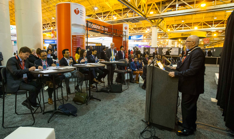 Speaker and attendees during  Health tech competition in Science and Technology Hall, Booth 1103 (the Simulation Zone booth)