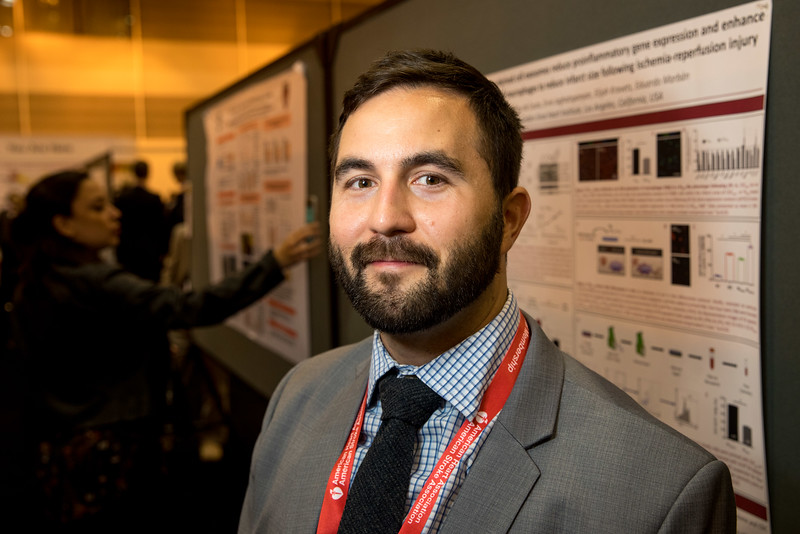 Geoffrey de Couto, PhD, during Science and Technology Hall, Basic Science Section, poster board 1160