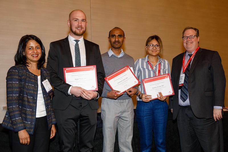 Joshua Beckman and Aruna Pradhan present awards during Council Dinner