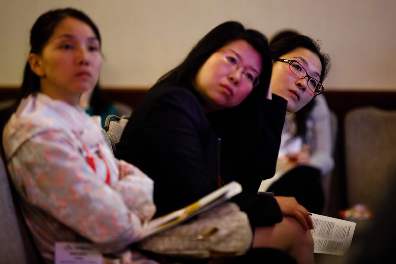 Attendees listen during Plenary III session