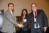 Joshua Beckman and Aruna Pradhan present awards during Council Dinner