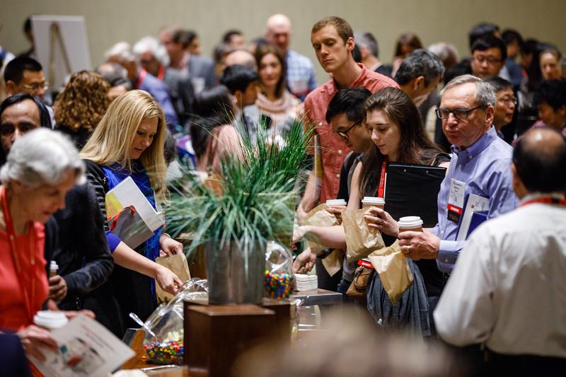 Attendees talk during coffee break