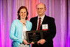 Alan Daugherty presents the Marten Hofker Memorial Award to Marjo MPC Donners, PhD, during Plenary III session