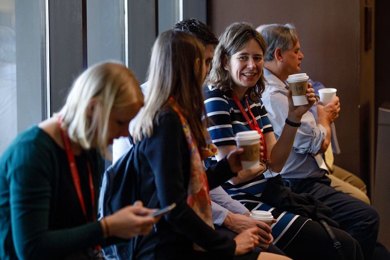 Attendees talk during Breakfast and registration