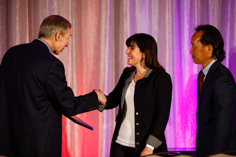 Steven Lentz and Philip S. Tsao present Jane Freedman the Keynote Lecture award during the Plenary session
