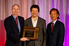 Steven Lentz and Philip S. Tsao present Klaus Ley the Distinguished Lecture award during the Plenary session