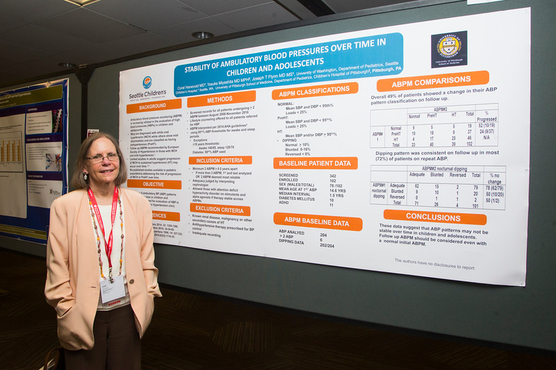 Stability of Ambulatory Blood Pressure Patterns Over Time in Children and Adolescents during Coral D. Hanevold poses for a portrait next to her poster titled