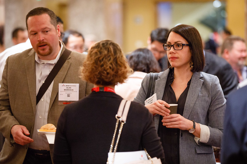 Attendees during breakfast and registration