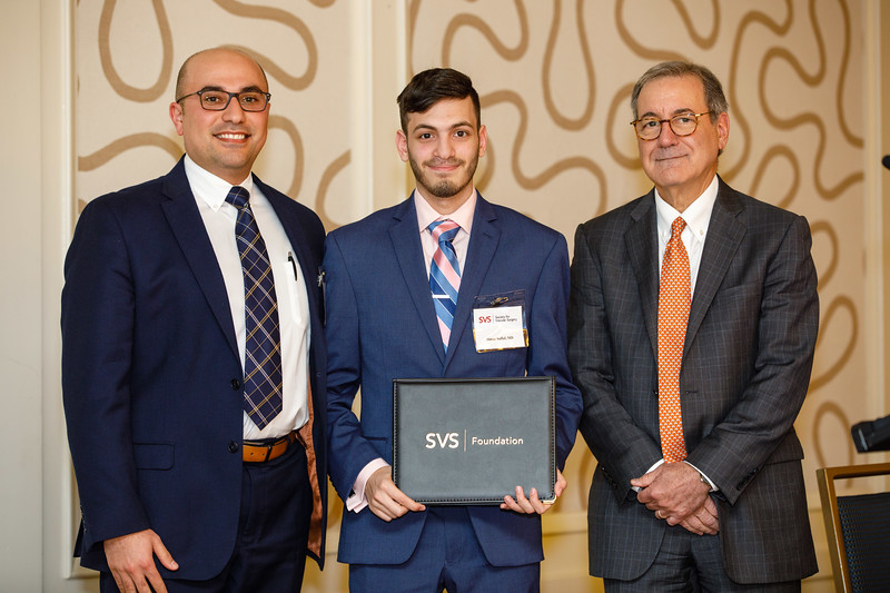 Ronald Fairman, MD, SVS Foundation Chair, presents an award to Omar Saffaf during SVS Foundation Update & Awards Ceremony